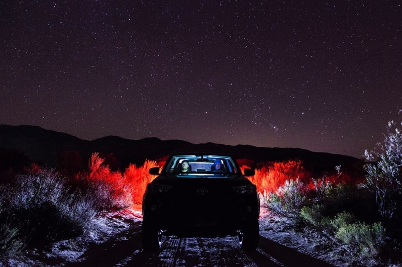 Car at night under sky
